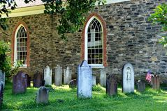 Sleepy Hollow, NY: 1685 Old Dutch Church. Old burial ground tombstones surround the historic 1685 Old Dutch Church of Sleepy Hollow built by Frederick Philipse Royalty Free Stock Image