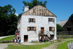 Sleepy Hollow, NY: C. 1750 Philipsburg Manor. Sheep walk on the pathways in front of the manor house built by Frederick Philipse at c. 1750 Philipsburg Manor in Stock Photo
