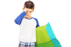Sleepy kid holding a pillow. Isolated on white background royalty free stock photos