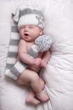 Sleepy little baby with cap stock photos