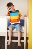 Sleepy little boy on bunk bed Royalty Free Stock Photography