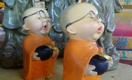 Sleepy little Buddhist monk dolls Stock Photography