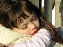 Sleepy Little Girl. Sweet young girl resting on her mother's shoulder Royalty Free Stock Image