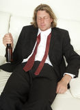 Sleepy Man with Beer Royalty Free Stock Photography