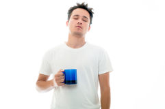 Sleepy man with blue mug Royalty Free Stock Image