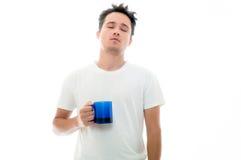 Sleepy man with blue mug Royalty Free Stock Image