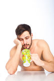 Sleepy man with a cup Royalty Free Stock Photos