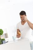 Sleepy man having breakfast at home Stock Photography
