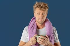 Sleepy man with a mug of coffee and a towel. Early morning royalty free stock photos