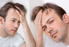 Sleepy man suffers from hangover Royalty Free Stock Photography