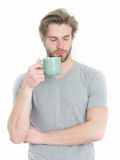 Sleepy man with tea or coffee cop in morning Royalty Free Stock Image