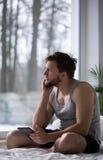 Sleepy man thinking about girlfriend Stock Photos