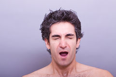 Sleepy man about to yawn Royalty Free Stock Photography