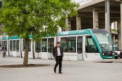 Sleepy man walking in the morning to the work and a tram stopped stock photography