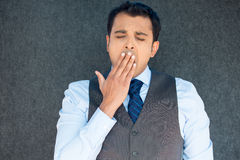 Sleepy man yawning Stock Images