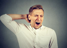 Sleepy man yawning stretching arms back. Sleep deprivation Royalty Free Stock Images