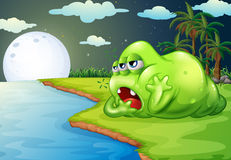 A sleepy monster at the riverside Stock Photography