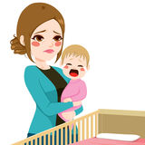 Sleepy Mother Consoling Baby Crying Royalty Free Stock Images