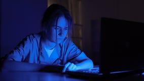 Sleepy nurse on duty sitting in dark room, exhausted by extra work in hospital. Stock footage stock footage