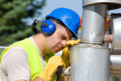 Sleepy oil worker Royalty Free Stock Photography