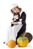 Sleepy Pilgrim with Her Dolly Royalty Free Stock Photos