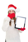 Sleepy Santa girl with tablet computer Royalty Free Stock Images