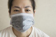 Sleepy sick woman mask flu cold health concept Stock Image