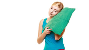Sleepy tired blonde girl with green pillow Stock Photography