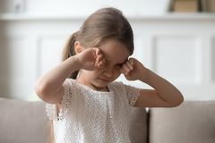 Sleepy tired upset little child crying rubbing eyes feel hurt. Sleepy stressed tired upset little child crying rubbing eyes feel abused hurt pain, sad lonely royalty free stock photo