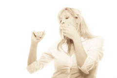 Sleepy tired woman yawning covering mouth with hand Stock Photos