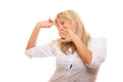 Sleepy tired woman yawning covering mouth with hand Stock Photo