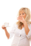 Sleepy tired woman yawning holds cup of coffee Royalty Free Stock Photos