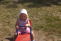 Sleepy toddler on the seesaw Royalty Free Stock Photo