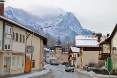 A sleepy town in the Alps. The picture was taken in Germany, in the resort town of Garmisch-Partenkirchen. In the photo one of the picturesque streets of a Stock Photography