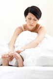 Sleepy woman is in bed. White background Stock Images