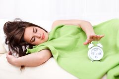 Sleepy woman in bed Royalty Free Stock Photography