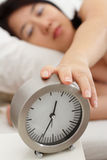 Sleepy Woman and Clock Royalty Free Stock Images