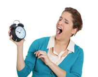Sleepy woman with clock Stock Image