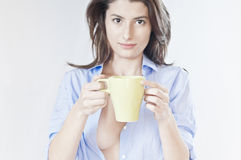 Sleepy woman with a cup of coffee in shirt Royalty Free Stock Photo