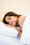 Sleepy woman in her bed Royalty Free Stock Images