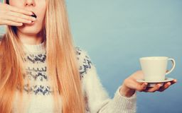 Sleepy woman holding cup of coffee Royalty Free Stock Image