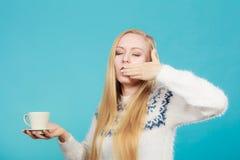 Sleepy woman holding cup of coffee Stock Photo