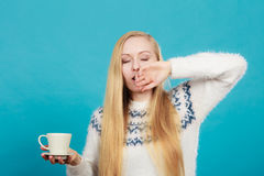 Sleepy woman holding cup of coffee Royalty Free Stock Photography