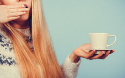 Sleepy woman holding cup of coffee Stock Photos