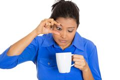 Sleepy woman holding a cup of tea royalty free stock photos