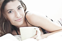 Sleepy woman and the mornin coffee Royalty Free Stock Photos