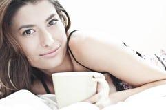 Sleepy woman and the mornin coffee Royalty Free Stock Photos