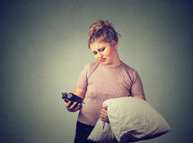 Sleepy woman with a pillow in hand. Beautiful sleepy woman with a pillow in hand Stock Image