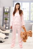 Sleepy woman in pyjama with teddy bear Royalty Free Stock Photos