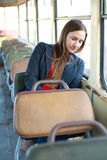 Sleepy woman resting in bus Royalty Free Stock Photo